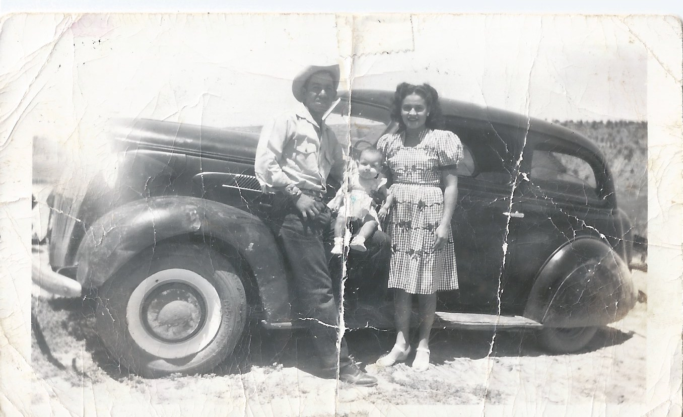 grandma grandpa and mom in front of black car 1940's