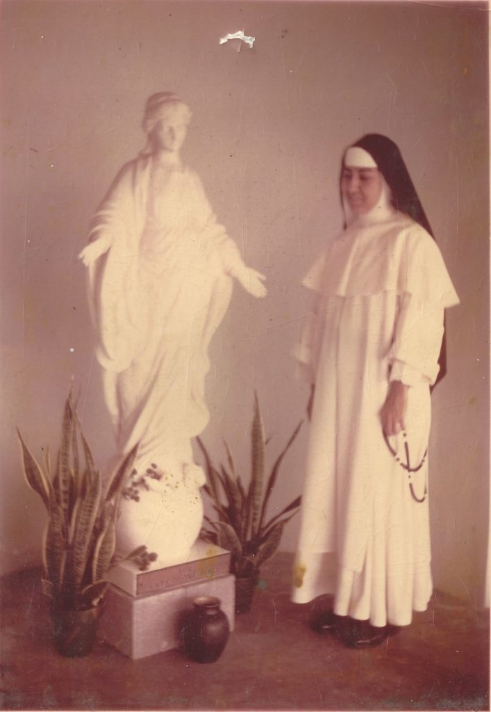 Nun Norma with statue