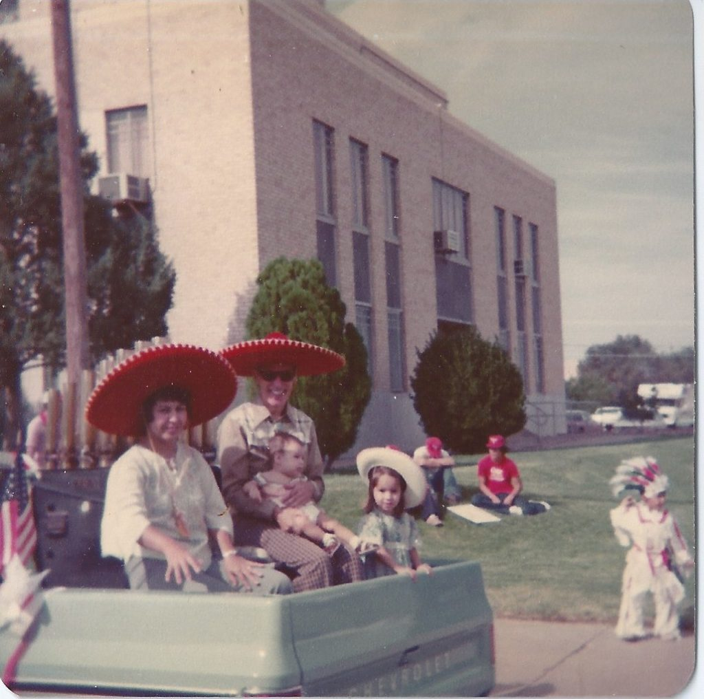 Norma, dad, older sister, and me at 4th of July parade