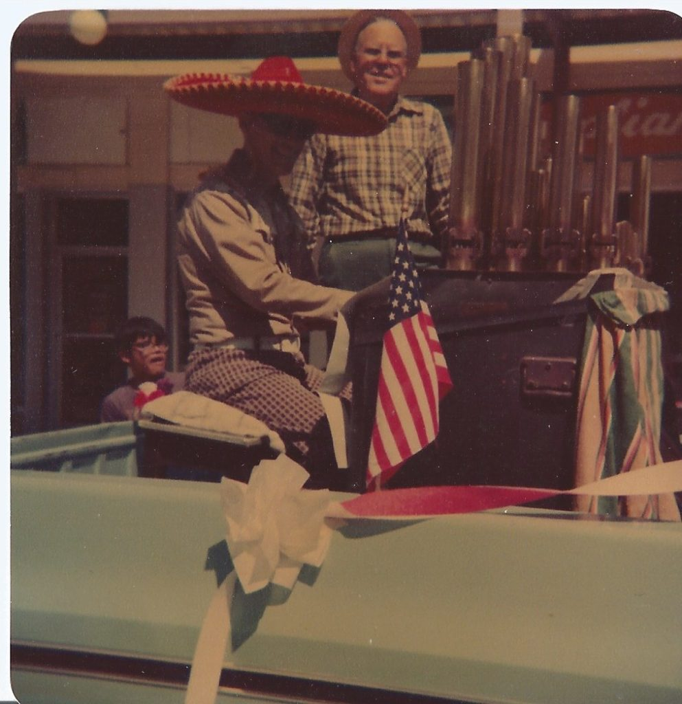 Dad playing organ at 4th of July parade