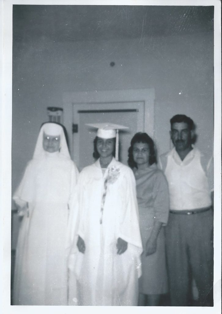 Norma graduating with nun and parents