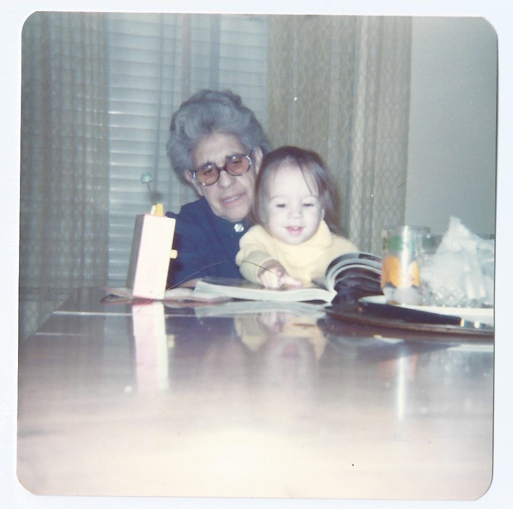 great grandma and older sister at table